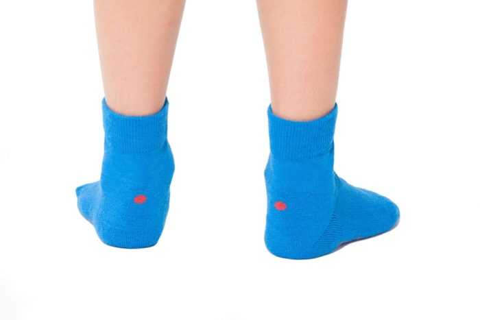 plus12socks kids feet wearing blue socks back view