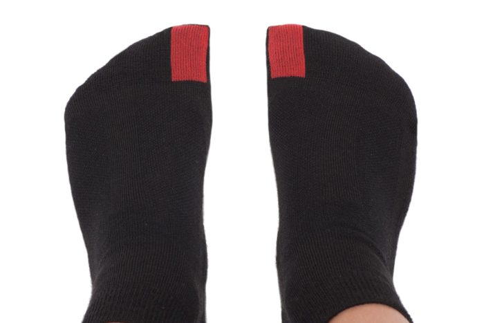 plus12socks kids feet wearing black socks view from above