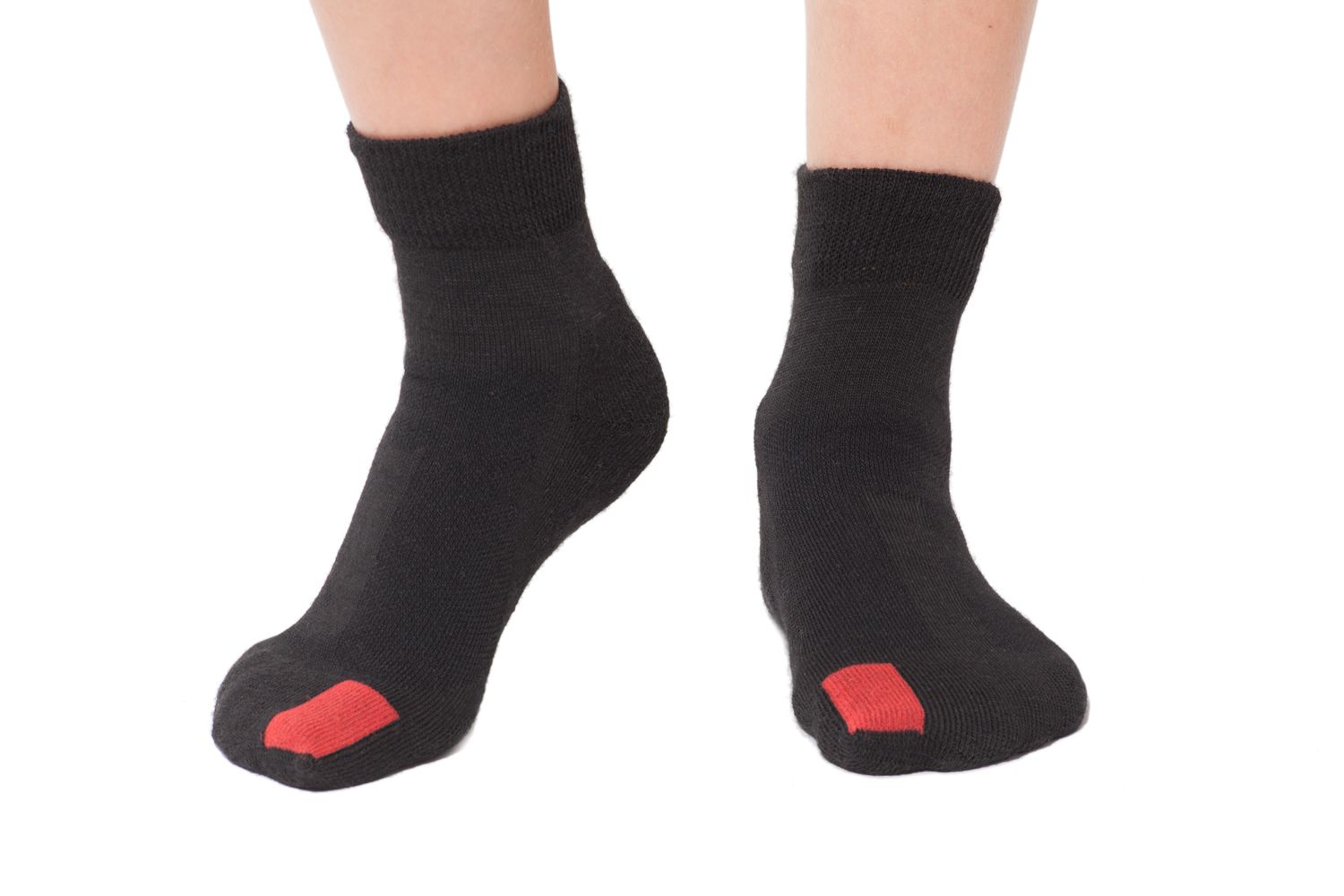 plus12socks kids feet wearing black socks front view
