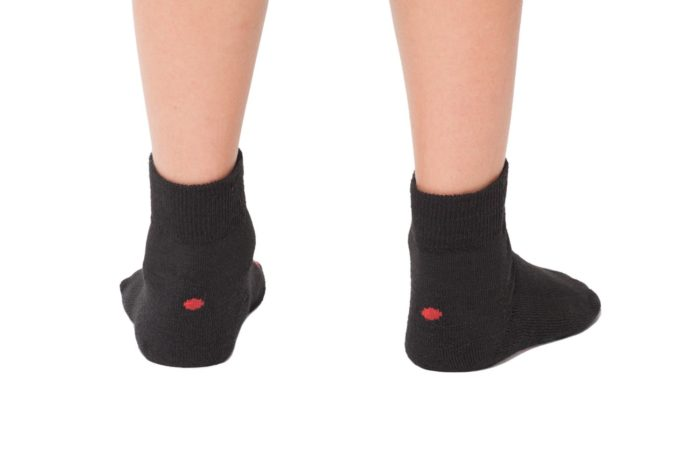 plus12socks kids feet wearing black socks back view
